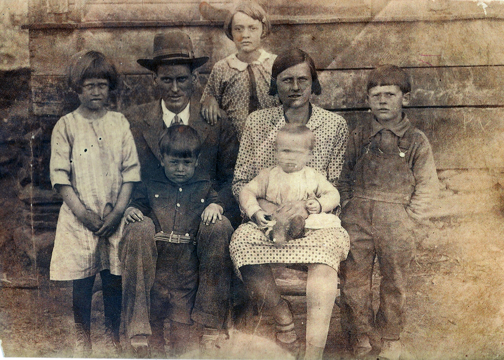 Appalachian woman, old cabin picture, old Appalachian family picture, old Smoky Mountain family picture, Smoky Mountain archive, Smoky Mountain woman, Appalachian woman in dress, Old picture of the Appalachian mountains, the old times