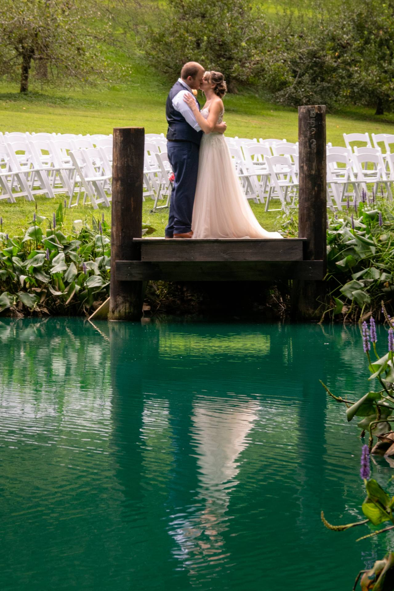 Bride and groom, lakeside wedding, Smoky Mountain lake wedding, Smoky Mountain wedding photography, Smoky Mountain wedding venue, Smoky Mountain wedding venue with lake, Smoky Mountain groom, Smoky Mountain field, Great Smoky Mountain National Park Weddings